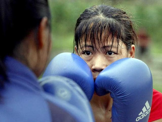 Five-time-world-boxing-champion-Mary-Kom-right-practices-with-her-student-in-Langol-Games-village-on-the-outskirts-of-Imphal-AP-Photo-Anupam-Nath