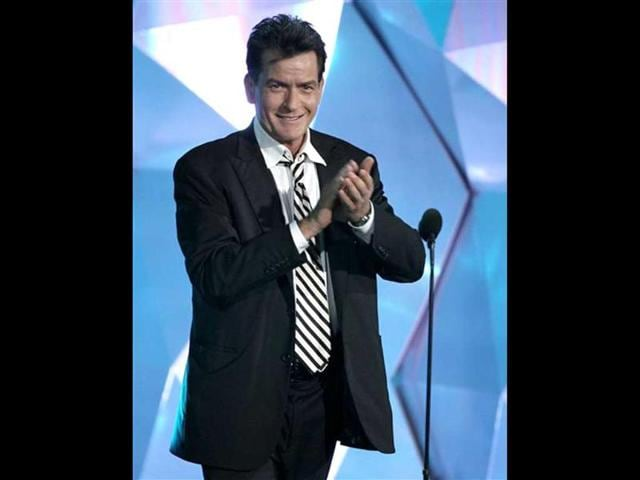 Charlie-Sheen-s-rockstar-image-in-Two-and-A-Half-Men-got-too-real-for-those-guys-over-at-Warner-Bros-and-his-character-was-killed-off-Recently-he-was-hailed-with-beer-cans-at-a-public-appearance