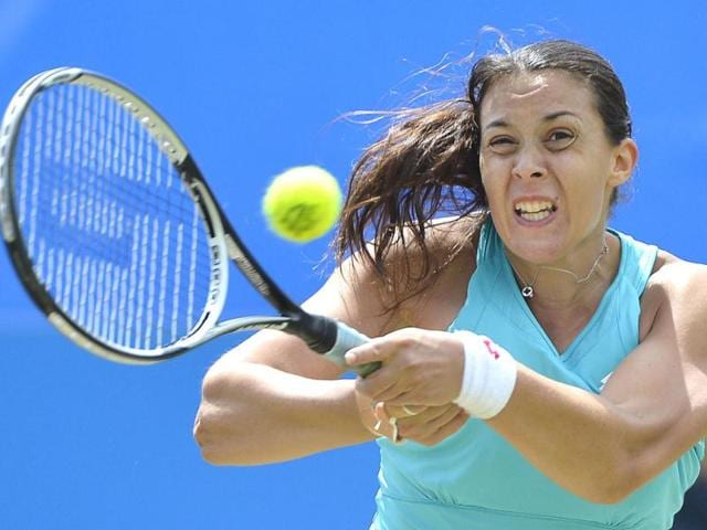Marion-Bartoli-of-France-returns-the-ball-against-Tamira-Paszek-of-Austria-during-their-women-s-singles-tennis-match-at-the-Eastbourne-tournament-in-Eastbourne-southern-England-Reuters-Toby-Melville