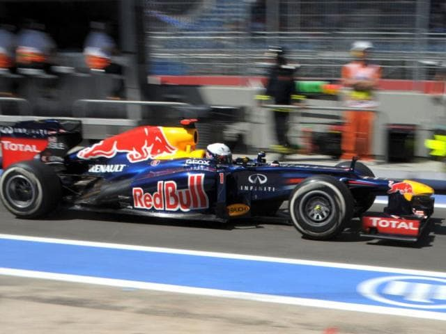 Red-Bull-Racing-s-German-driver-Sebastian-Vettel-leaves-the-pits-at-the-Valencia-Street-Circuit-in-Valencia-during-the-third-practice-race-of-the-European-Formula-One-Grand-Prix-AFP-Tom-Gandolfini