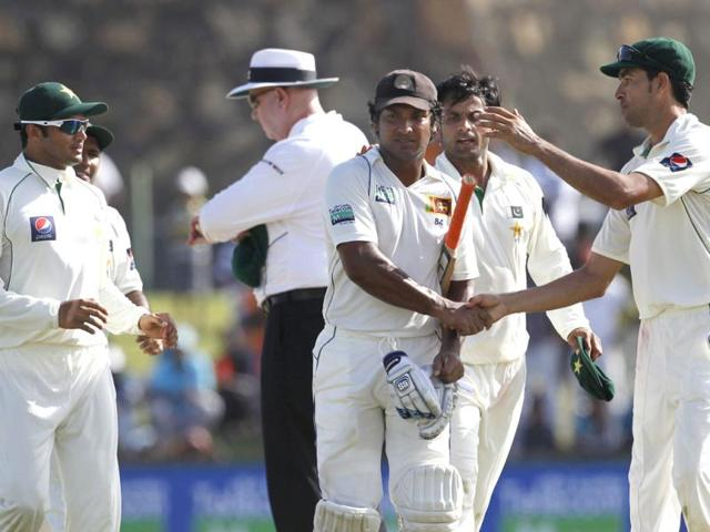 Pakistan-s-stand-in-captain-Mohammad-Hafeez-second-right-and-Umar-Gul-right-congratulate-Sri-Lankan-batsman-Kumar-Sangakkara-who-scored-an-unbeaten-199-runs-during-their-Test-cricket-match-against-Pakistan-in-Galle-Sri-Lanka-Azhar-Ali-is-in-far-left-AP-Gemunu-Amarasinghe