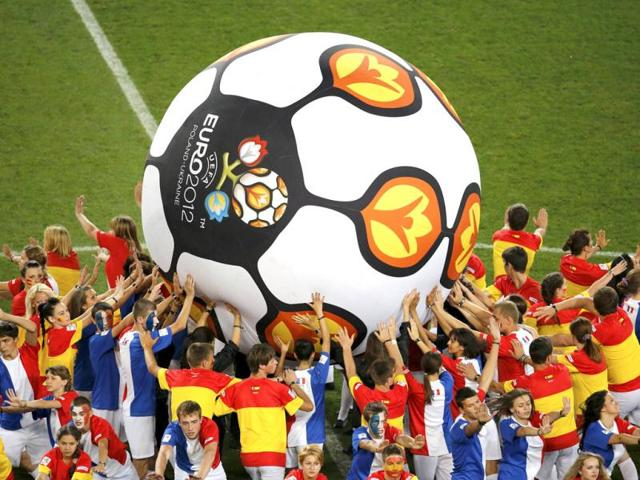 Performers-push-a-giant-soccer-ball-with-the-Euro-2012-logo-before-the-quarter-final-soccer-match-between-Spain-and-France-Reuters-Yves-Herman