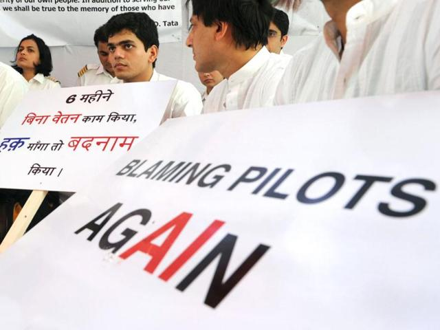 Striking-Air-India-pilots-hold-placards-during-a-hunger-strike-in-New-Delhi-AFP-Photo-Sajjad-Hussain
