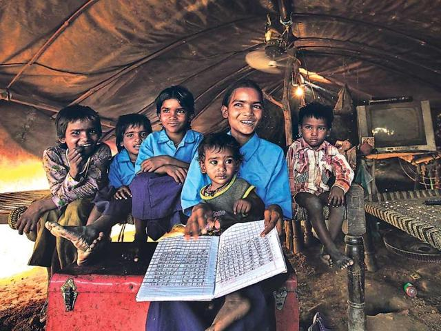 Ten-year-old-Meenakshi-has-enrolled-in-Class-3-at-an-MCD-school-Some-of-her-siblings-will-also-be-attending-school-in-July-HT-Raj-K-Raj