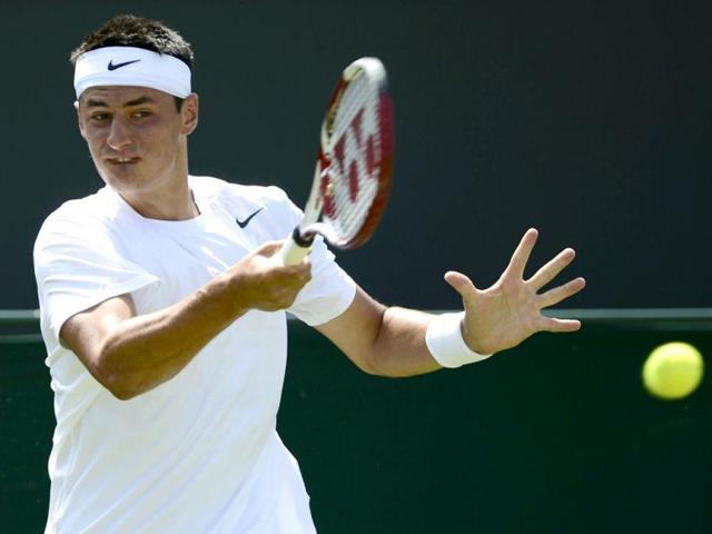 Bernard-Tomic-of-Australia-hits-a-return-to-David-Goffin-of-Belgium-during-their-men-s-singles-tennis-match-at-the-Wimbledon-tennis-championships-in-London-Reuters-photo-Dylan-Martinez