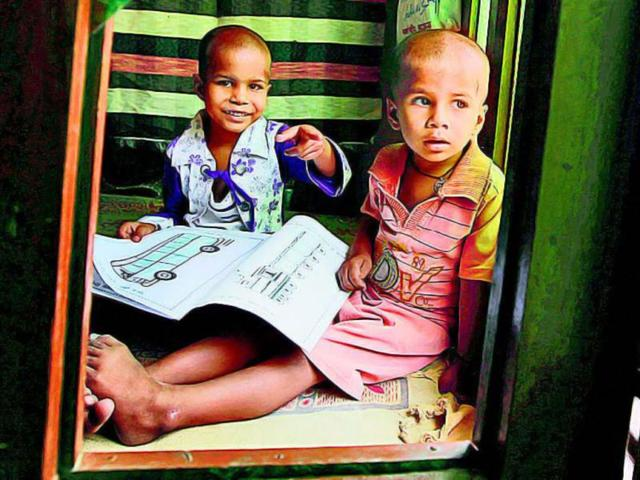 Six-year-old-Renu-right-takes-time-out-to-teach-her-younger-brother-Vansh-at-their-home-in-northeast-Delhi--Raj-K-Raj-HT-Photo