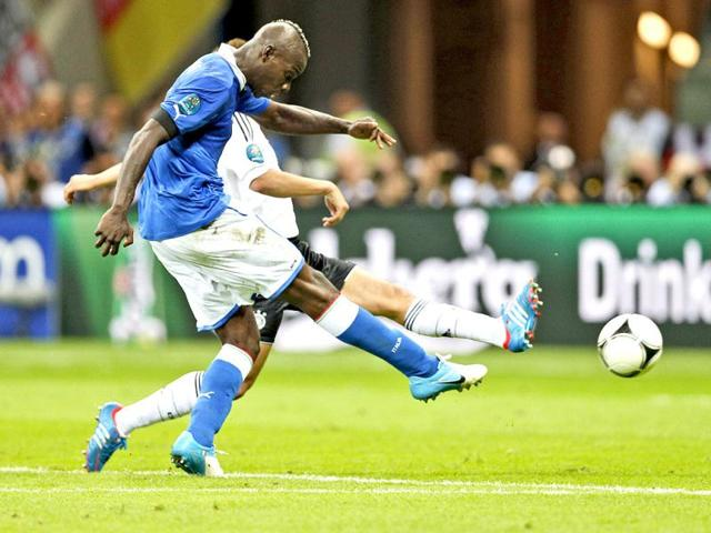 Italy-s-Mario-Balotelli-C-celebrates-after-scoring-during-the-Euro-2012-soccer-championship-semifinal-match-between-Germany-and-Italy-in-Warsaw-Poland-AP-Photo-Frank-Augstein