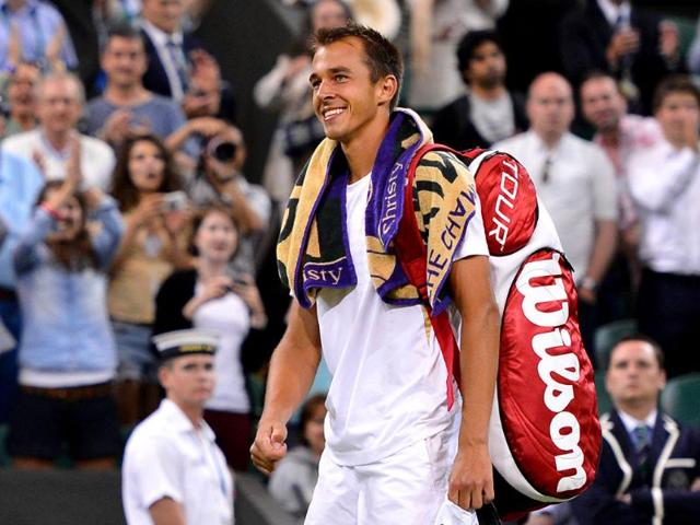 Czech-Republic-s-Lukas-Rosol-smiles-as-he-leaves-the-court-after-his-victory-over-Spain-s-Rafael-Nadal-in-their-second-round-men-s-singles-match-at-the-All-England-Tennis-Club-in-Wimbledon-southwest-London-AFP-Miguel-Medina