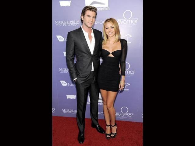 Actor-Liam-Hemsworth-an-honoree-at-the-Australians-in-Film-8th-Annual-Breakthrough-Awards-poses-with-his-fiance-Miley-Cyrus-AP-photo