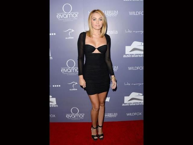 Miley-Cyrus-has-been-flaunting-her-recently-gained-toned-figure-a-lot-The-actress-was-recently-seen-in-a-black-revealing-dress-which-makes-her-look-as-if-she-is-wearing-a-bra-AFP-photo