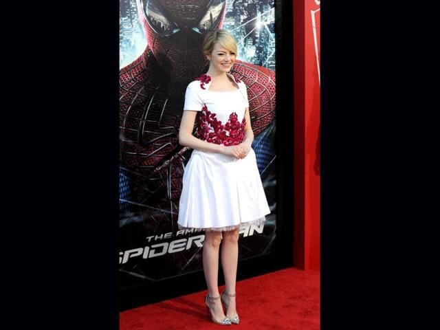 Emma-Stone-looked-pretty-at-the-Amazing-Spider-Man-premiere-in-a-white-frock-with-red-flowers-teamed-with-elegant-stilettos