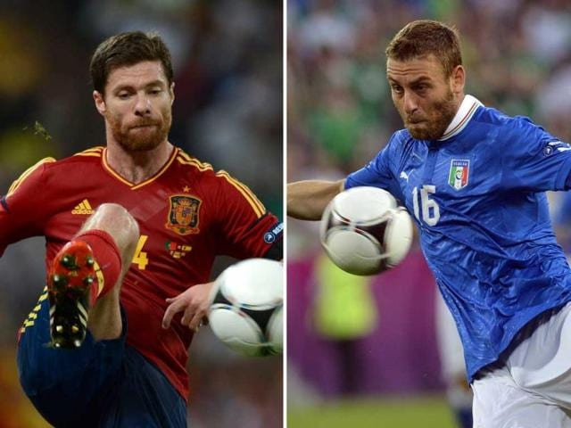 A-combo-picture-showing-Spanish-midfielder-Xabi-Alonso-and-Italian-midfielder-Daniele-De-Rossi-AFP-Jeff-Pachoud-Odd-Andersen