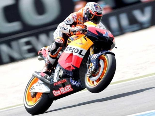 Casey-Stoner-took-his-third-win-of-the-season-to-draw-level-in-the-MotoGP-championship-with-Jorge-Lorenzo-AP-PHOTO