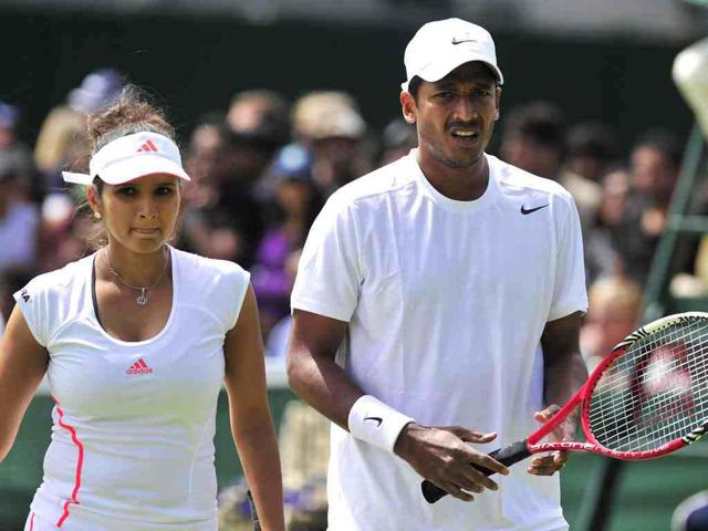 Sania-Mirza-with-Mahesh-Bhupathi-during-their-second-round-mixed-doubles-match-against-Australia-s-Paul-Hanley-and-Russia-s-Alla-Kudryavtseva-on-day-six-of-the-2012-Wimbledon-Championships-tennis-tournament-at-the-All-England-Tennis-Club-in-Wimbledon-AFP-Glyn-Kirk