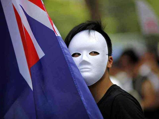 A-pro-democracy-protestor-carries-a-Hong-Kong-colonial-flag-as-he-marches-along-downtown-Hong-Kong-Retuers-Carlos-Barria