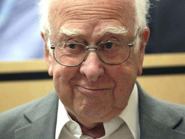 British-physicist-Peter-Higgs-arrives-for-the-opening-of-a-seminar-to-deliver-the-latest-update-in-the-50-year-bid-to-explain-a-riddle-of-fundamental-matter-in-the-search-for-a-particle-called-the-Higgs-boson-at-CERN-in-Meyrin-near-Geneva-AFP-photo-Fabrice-Coffrini