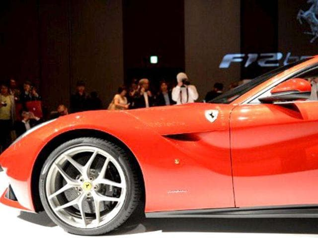 The latest Ferrari F12 Berlinetta is displayed during its Japan premier in Tokyo. Equipped with new a V12 6,262-cc engine, Ferrari's flagship F12 Berlinetta was first unveiled at the March 2012 Geneva Motor Show. AFP Photo/Toshifumi Kitamura