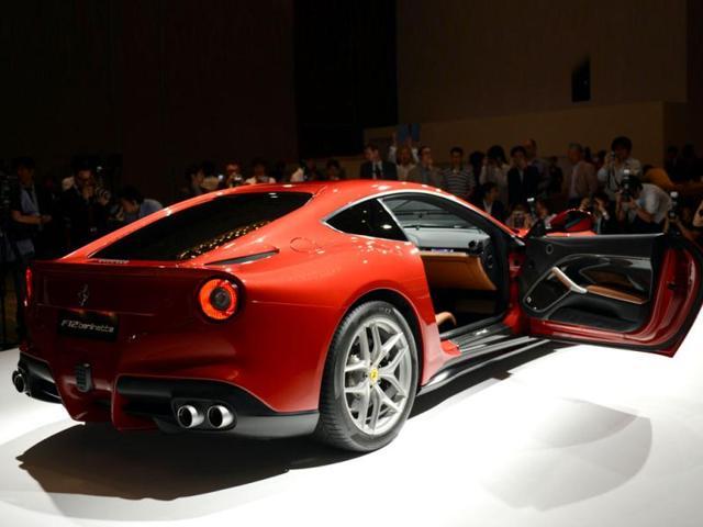 The latest Ferrari F12 Berlinetta is displayed during its Japan premier in Tokyo. AFP Photo/Toshifumi Kitamura