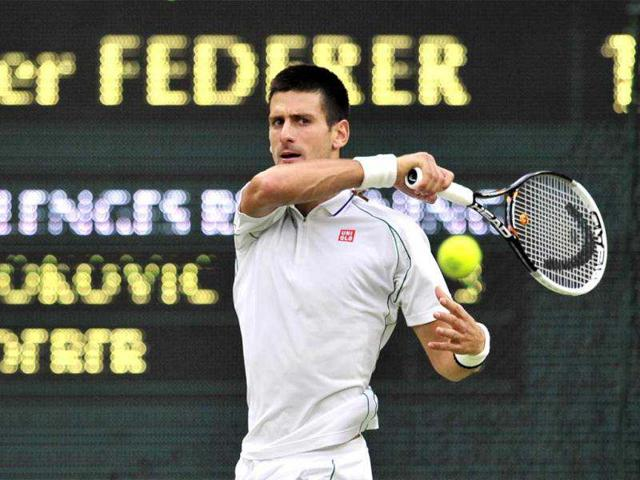 Novak-Djokovic-plays-a-forehand-shot-during-his-men-s-singles-semi-final-match-against-Roger-Federer-on-day-11-of-the-2012-Wimbledon-Championships-tennis-tournament-at-the-All-England-Tennis-Club-in-Wimbledon-southwest-London-AFP-Gyn-Kirk