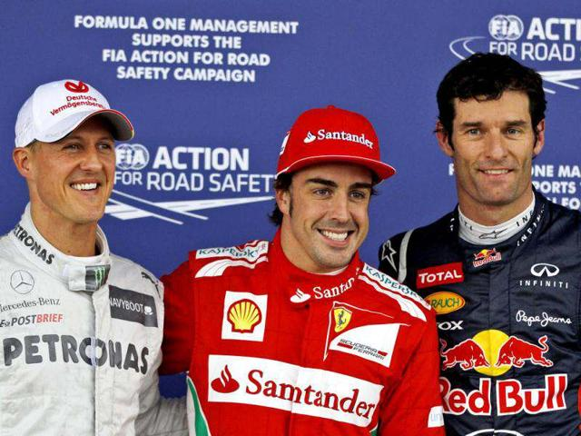 Fernando-Alonso-centre-took-Ferrari-s-first-pole-position-of-the-2012-season-as-Michael-Schumacher-left-set-yet-another-top-three-time-in-qualifying-AP-Photo