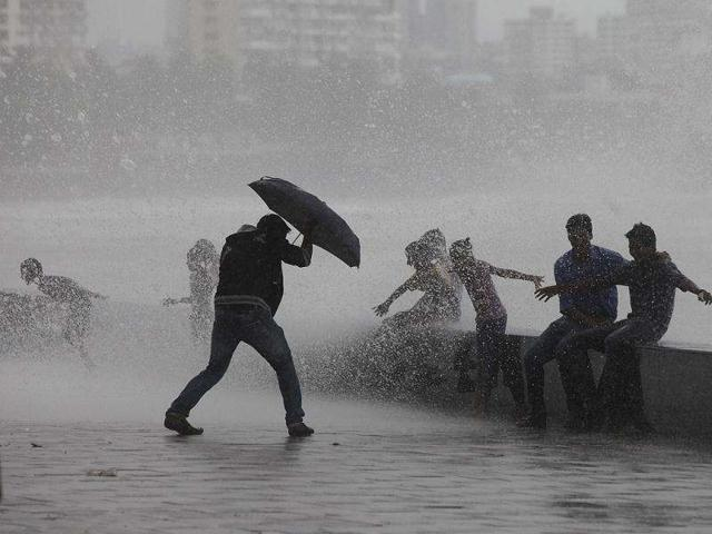A-boy-tries-saving-himself-with-an-umbrella-during-the-hightide-at-Worli-in-Mumbai-HT-Kalpak-Pathak
