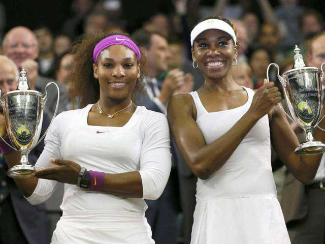 Venus-Williams-of-the-US-R-and-her-partner-Serena-Williams-of-the-US-hold-their-trophies-after-defeating-Andrea-Hlavackova-of-the-Czech-Republic-and-Lucie-Hradecka-of-the-Czech-Republic-in-their-women-s-doubles-tennis-match-at-the-Wimbledon-tennis-championships-REUTERS-Stefan-Wermuth
