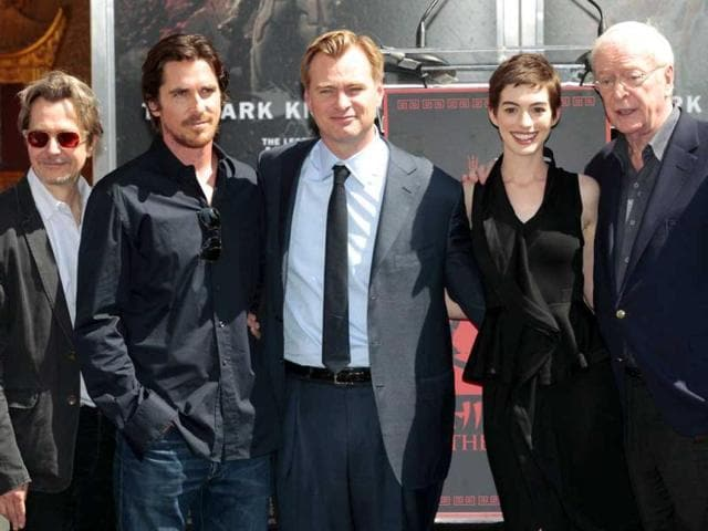 Director-Christopher-Nolan-C-poses-with-the-prominent-Dark-Knight-Rises-actors-from-L-R-Morgan-Freeman-Gary-Oldman-Christian-Bale-Anne-Hathaway-Michael-Caine-and-Joseph-Gordon-Levitt-at-his-hand-and-footprint-ceremony-in-the-forecourt-of-the-Grauman-s-Chinese-Theatre-in-Hollywood-California