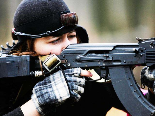 A-woman-aims-a-Kalashnikov-assault-rifle-during-a-laser-tag-outdoor-game-near-the-city-of-Rostov-on-Don-Reuters