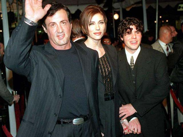 Sylvester-Stallone-star-of-the-film-Daylight-arrives-at-the-film-s-world-premiere-with-his-girlfriend-Jennifer-Flavin-and-his-son-Sage-Stallone-AP-Kevork-Djansezian