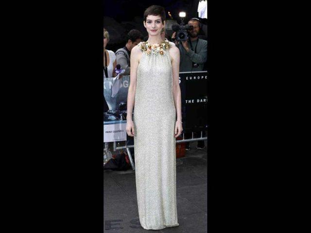 US-actress-Anne-Hathaway-poses-for-photographers-as-she-arrives-at-the-European-Premiere-of-The-Dark-Knight-Rises-in-Leicester-Square-central-London-Reuters-Andrew-Winning