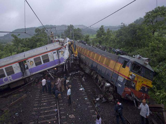 Rescue-personnel-work-near-the-derailed-locomotive-of-the-Vidarbha-Express-and-a-local-commuter-train-near-Kasara-about-100km-from-Mumbai-Reuters-photo-Vivek-Prakash