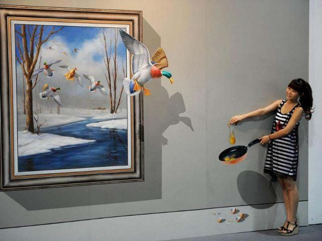 This-picture-shows-a-visitor-posing-with-a-3D-painting-at-the-Magic-Art-Special-exhibition-at-the-Hangzhou-Peace-International-Exhibition-and-Conference-Centre-in-the-eastern-Chinese-city-of-Hangzhou-AFP-photo-Peter-Parks