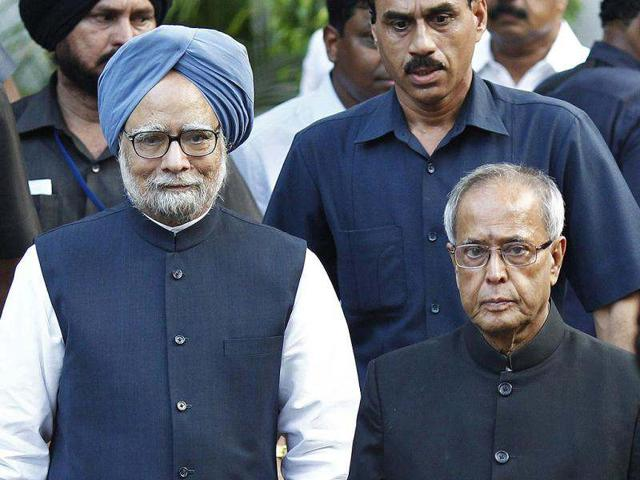 Prime Minister Manmohan Singh poses for a picture with the newly elected President Pranab Mukherjee in New Delhi. Reuters photo/Adnan Abidi