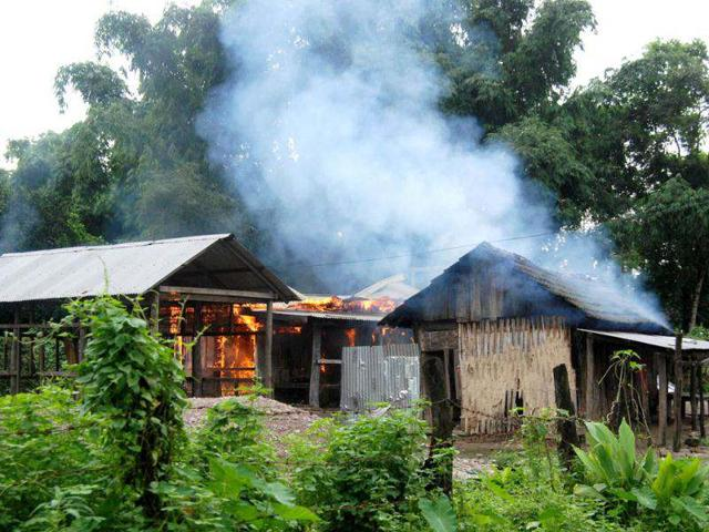 A-house-burns-after-violent-ethnic-clashes-at-Kachugaon-village-in-Kokrajhar-district-about-230-kms-from-Guwahati-Assam--AFP-PHOTO