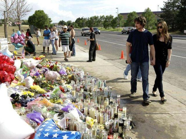 Actor Christian Bale and his wife Sandra Blazic leave the memorial across the street from the Century 16 movie theater July 24, 2012 in Aurora, Colorado. The memorial was created for the victims of the mass shooting that occured at the theater last Friday.