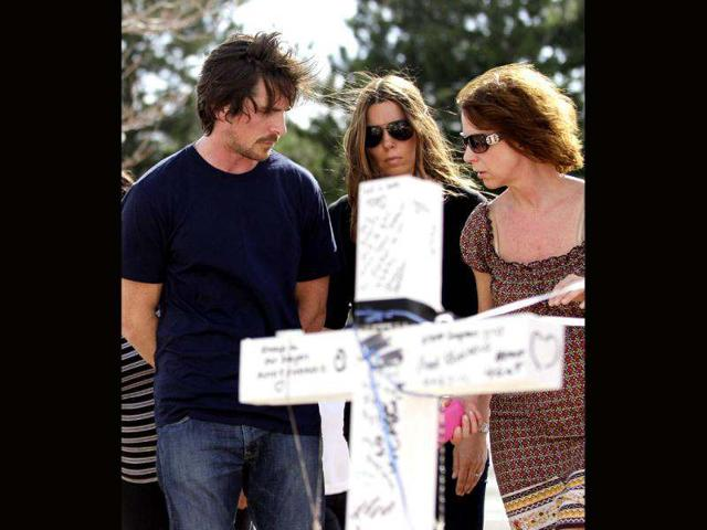 Actor Christian Bale and his wife Sandra Blazic at the memorial across the street from the Century 16 movie theater in Aurora, Colorado. The memorial was created for the victims of the mass shooting that occured at the theater last Friday.