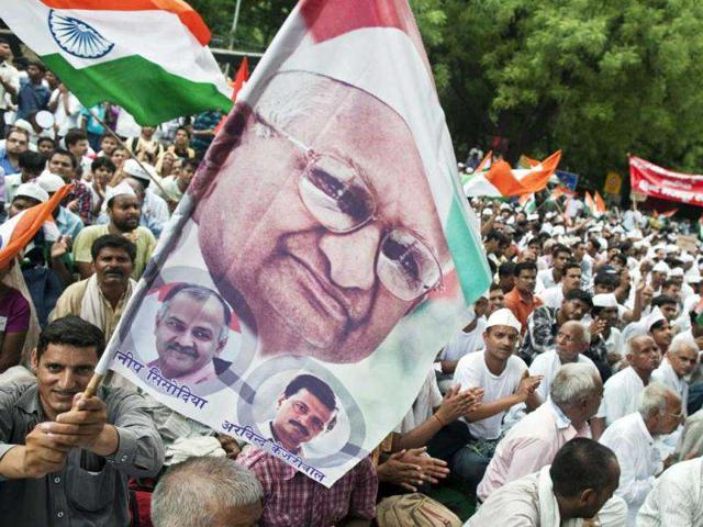 A-supporter-waves-a-flag-containing-a-portrait-of-social-activist-Anna-Hazare-top-during-a-protest-in-New-Delhi-Reuters-Ahmad-Masood