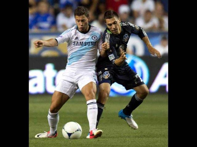 MLS-All-Stars-Michael-Farfan-R-vies-for-the-ball-with-Chelsea-FC-s-Eden-Hazard-during-the-2012-AT-amp-T-All-Star-match-at-PPL-Park-in-Philadelphia-AFP-Jim-Watson