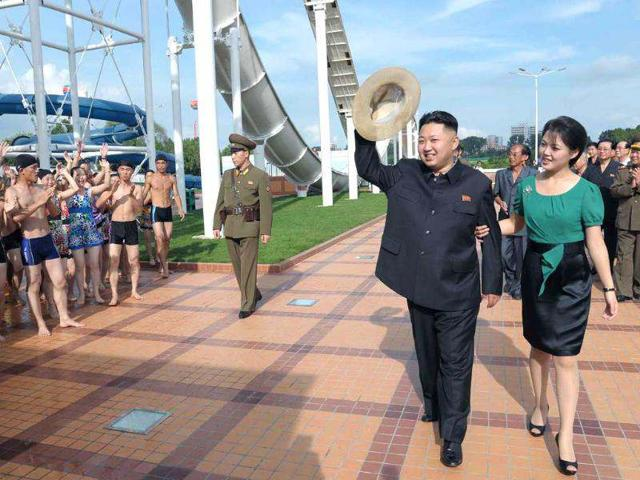 North-Korean-leader-Kim-Jong-Un-accompanied-by-his-wife-Ri-Sol-Ju-waves-to-the-crowd-as-they-inspect-the-Rungna-People-s-Pleasure-Ground-in-Pyongyang-AP-Korea-News-Service