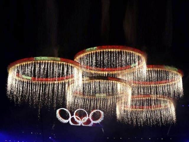 The-Olympic-rings-are-illuminated-during-the-Opening-Ceremony-at-the-2012-Summer-Olympics-in-London-AP-Photo-Matt-Slocum