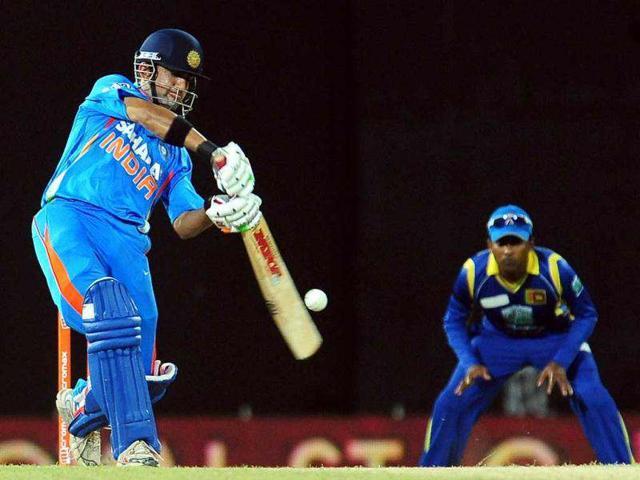 Indian-cricketer-Gautam-Gambhir-plays-a-shot-as-Sri-Lankan-captain-Mahela-Jayawardene-looks-on-during-the-third-one-day-international-ODI-match-between-Sri-Lanka-and-India-at-the-R-Premadasa-Cricket-Stadium-in-Colombo-AFP-Lakruwan-Wanniarachchi