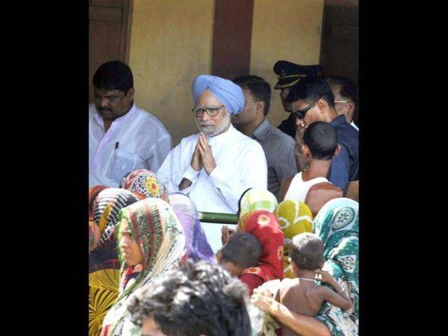 Digambar Patowary,Tarun Gogoi,Manmohan Singh