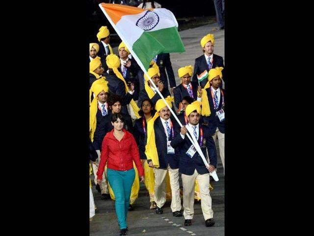 An-unidentified-lady-in-red-shirt-walks-besides-flag-bearer-Sushil-Kumar-during-the-Indian-team-s-parade-at-the-opening-ceremony-of-the-Olympic-Games-2012-in-London-PTI-Photo-by-Manvender-Vashist