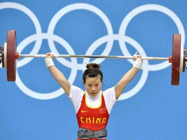 China-s-Wang-Mingjuan-lifts-during-the-women-s-48kg-group-A-weightlifting-competition-at-The-Excel-Centre-in-London-during-the-2012-Olympic-Games-AFP-Yuri-Cortez