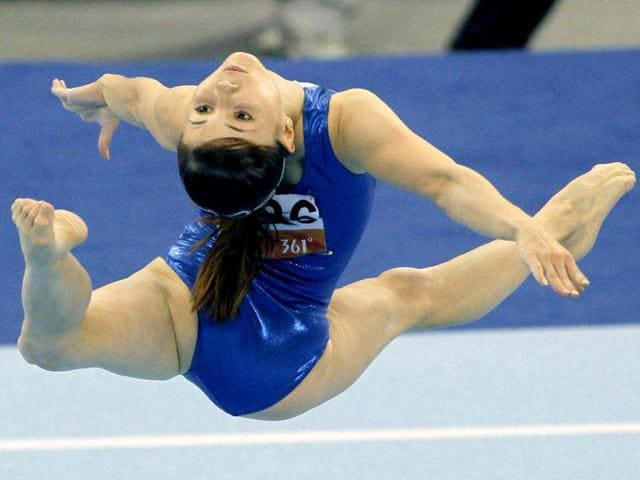 This-file-photo-shows-Uzbekistan-s-Galiulina-Luiza-performing-during-the-women-s-floor-exercise-gymnastics-at-the-16th-Asian-Games-in-Guangzhou-China-AP-Photo