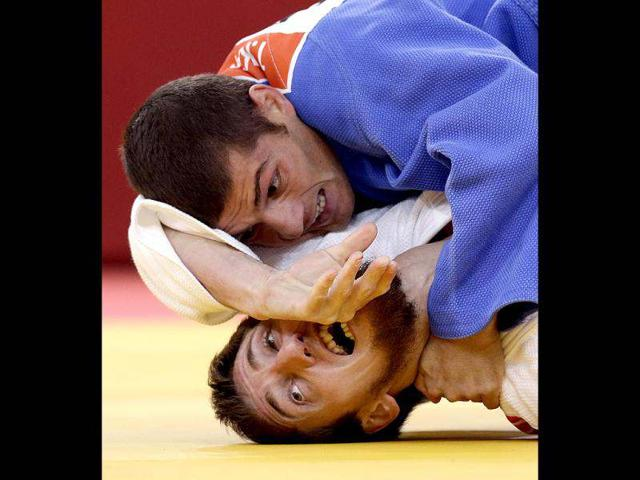 Tarlan-Karimov-of-Azerbaijan-in-blue-competes-against-Musa-Mogushkov-of-Russia-during-the-men-s-66kg-judo-competition-at-the-2012-Summer-Olympics-in-London-AP-Photo