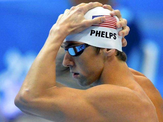 Michael-Phelps-of-the-US-adjusts-his-swim-cap-before-his-men-s-200m-butterfly-heat-at-the-London-2012-Olympic-Games-at-the-Aquatics-Centre-Reuters-Toby-Melville