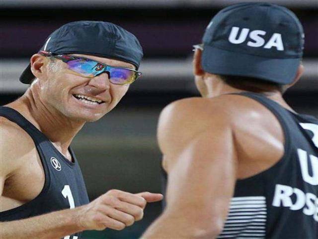 Jake-Gibb-left-of-US-celebrates-with-his-teammate-Sean-Rosenthal-right-during-their-Beach-Volleyball-match-against-South-Africa-at-the-2012-Summer-Olympics-in-London-AP-Photo-Petr-David-Josek