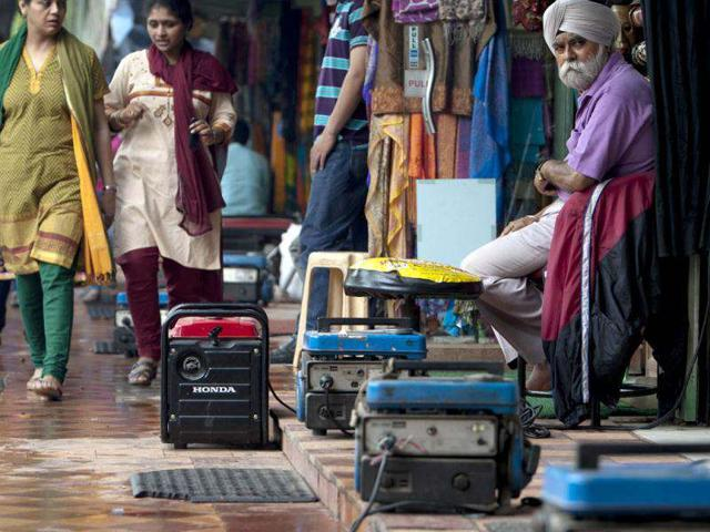 Portable power generators provide electrical power to souvenir shops along Janpath Market, during a power outtage in New Delhi. (AFP Photo)