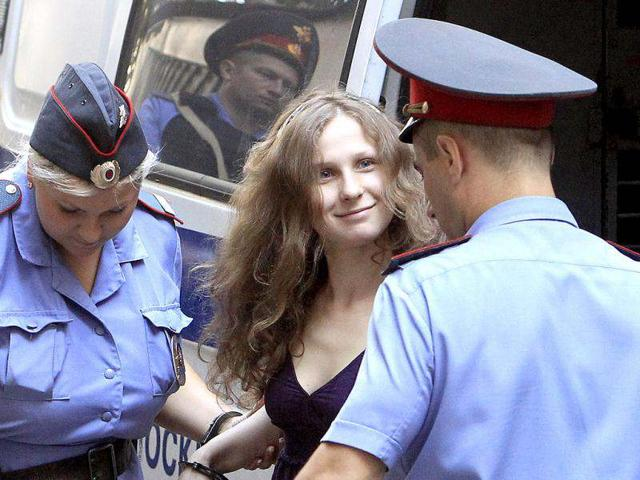 Feminist-punk-group-Pussy-Riot-member-Maria-Alekhina-sits-inside-a-glass-cage-at-a-court-in-Moscow-Russia-AP-Photo